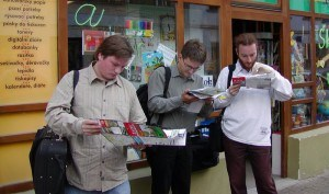 Tourists looking at guide books and maps