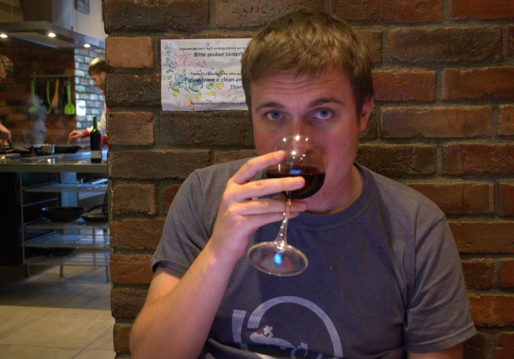 Drinking wine in a hostel in Vienna, Austria