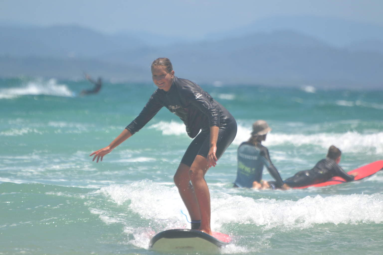 Another one of the surfers in my class. In the background you can see another surfer receiving instruction.