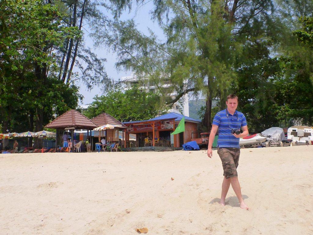 travel photographer on a beach
