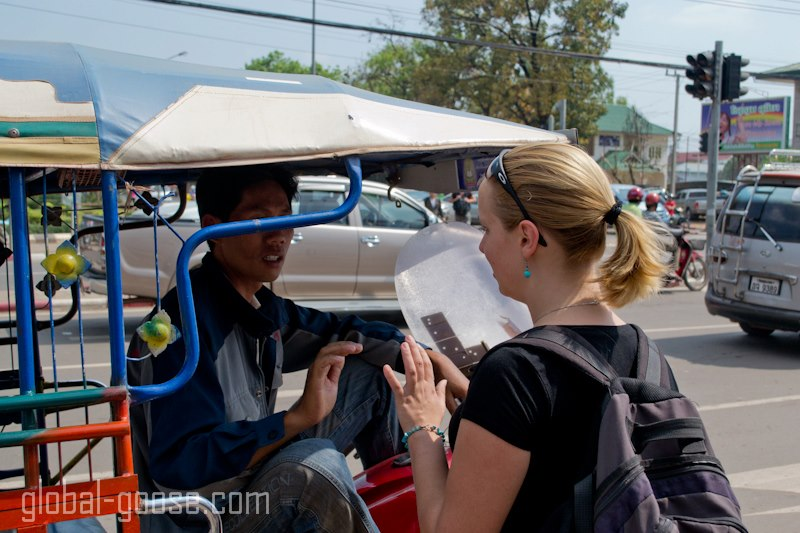 Me negotiating with a Tuk Tuk driver in Vientiane, Laos