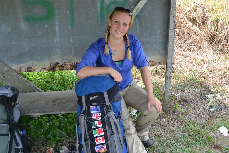 This is me waiting for a bus on the side of the road in Borneo with everything I own.
