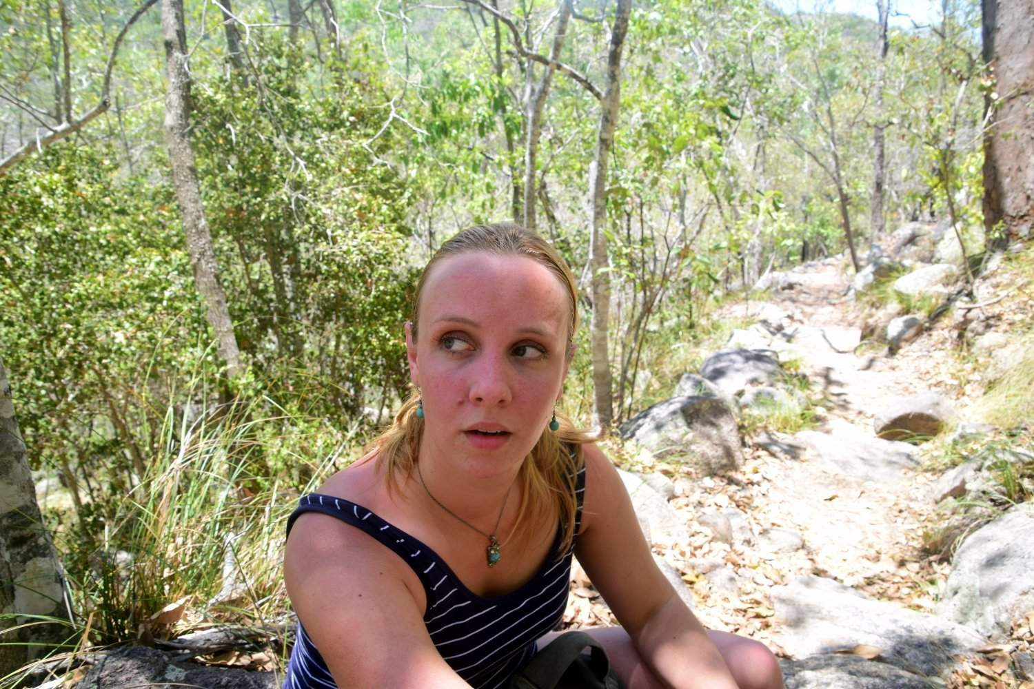 Red-faced and sweaty after hiking in the sunshine.
